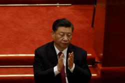 Xi's vision for shared destiny draws applause