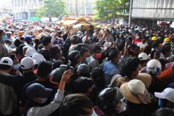 Large crowds attend funeral of teenage protester shot dead in Mandalay
