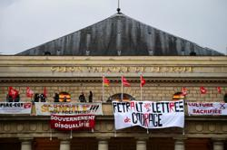 Jobless French culture workers occupy 19th century theatre to demand aid