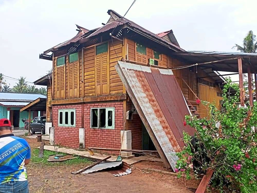 One of the damaged houses in a village in Pinang Tunggal.
