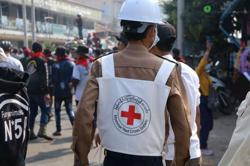 Red Cross says volunteers hurt in Myanmar, urges halt to violence