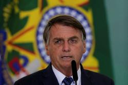 Brazil's Bolsonaro says pandemic aid payments could vary in value