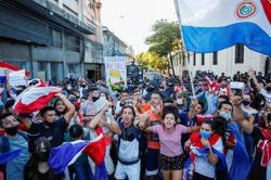 Fire, smoke, gunshots in Paraguay capital as pandemic response ignites protests