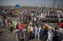 Indian farmers block highway outside Delhi to mark 100th day of protest as Covid-19 cases are surging again