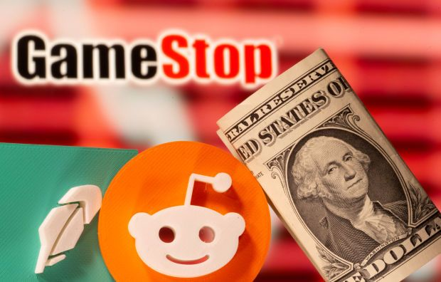 A 3d printed Robinhood and Reddit logos are seen near one dollar banknotes in front of displayed GameStop logo - Reuters file pic