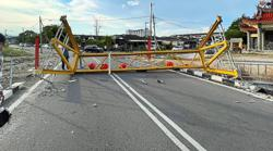 Bridge temporarily closed after lorry rams into height bar