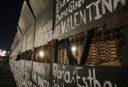 Activists paint barriers with names of female victims of violence in Mexico
