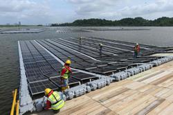 Singapore builds floating solar farms in climate fight