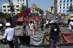 Shops, factories closed, sarongs waved as protests intensify in Myanmar (update)