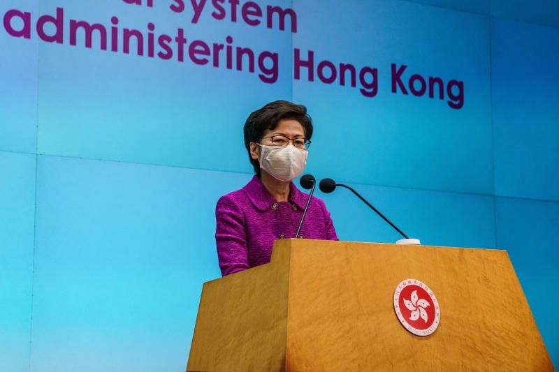 Carrie Lam, Hong Kong's chief executive, wears a protective mask while speaking during a news conference in Hong Kong, China, on Monday, March 8, 2021. China advanced sweeping plans to curb the role of opposition activists in Hong Kong elections, with local media reports saying a vote for the city's legislature would be delayed another year to September 2022. - Bloomberg
