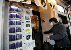 Vending machines sell PCR test kits in Japan