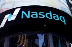 Nasdaq hits correction, Dow advances as stimulus bill nears finish line