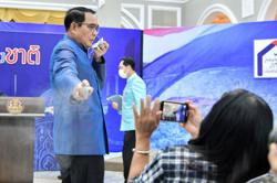 Irked Thai PM sprays reporters with hand sanitiser to duck tricky questions