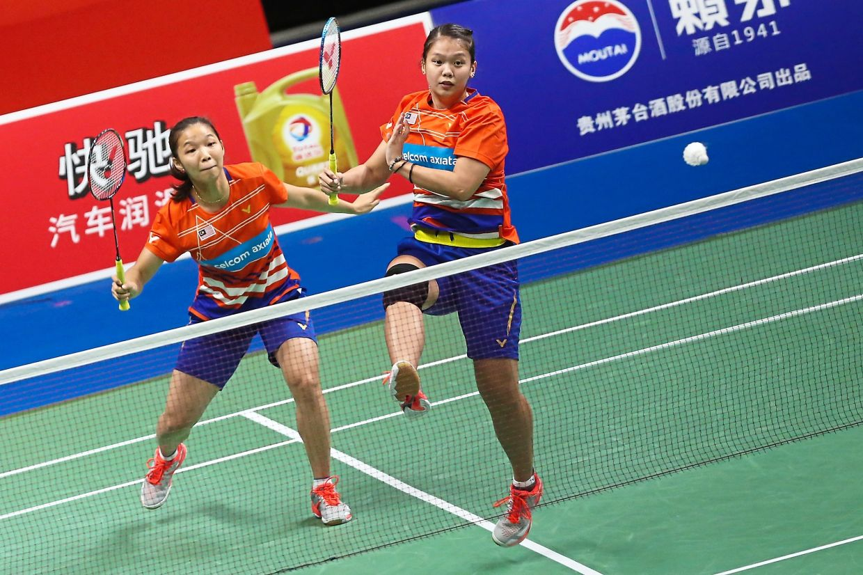 Not good enough: National No. 1 Chow Mei Kuan (left) and Lee Meng Yean were eliminated by Pearly Tan-M. Thinaah in the Swiss Open semi-finals in Basel last week.