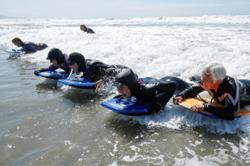Silver-haired ladies cut loose on California surf
