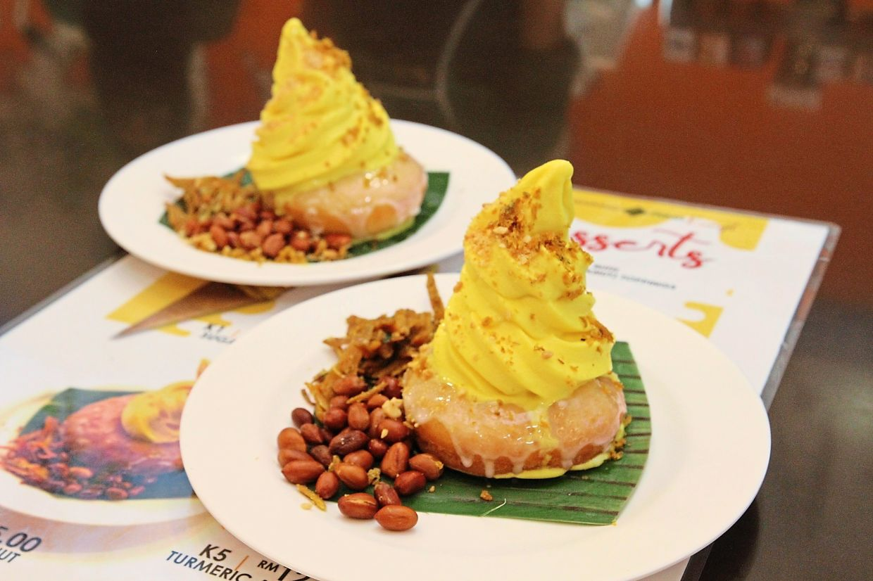 Turmeric is incorporated into Malaysia's first soft serve ice cream, which sits on top of a handmade glazed doughnut at Warung Prima Kunyit.