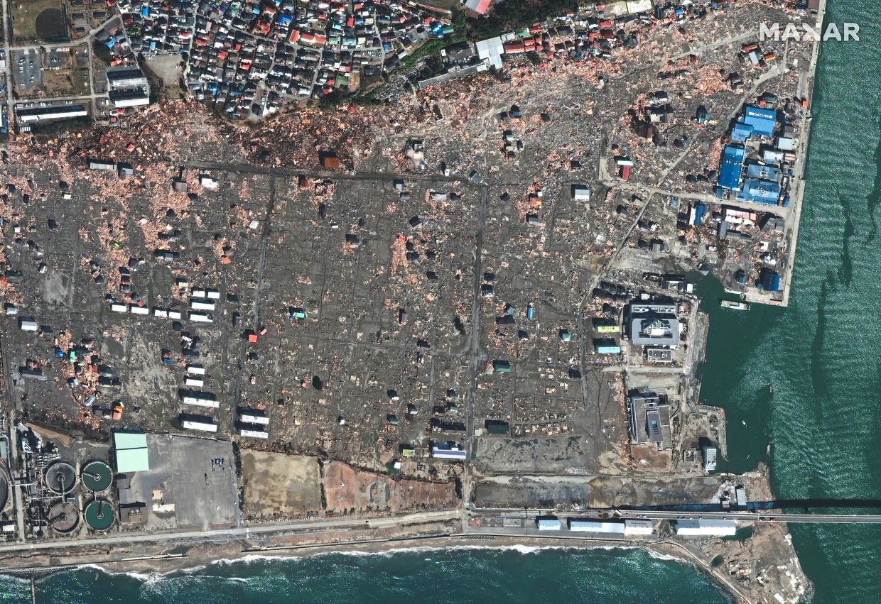 Just after: A view of the destroyed homes and buildings in Ishinomaki, taken following the tsunami, in 2011. — Reuters
