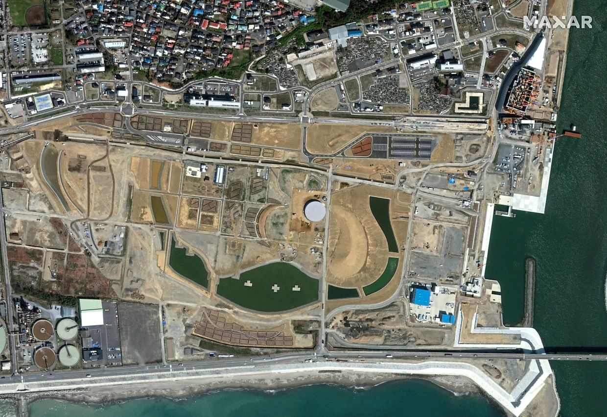 Latest: A view of Ishinomaki after the tsunami in this image taken in April last year, showing progress. — Reuters