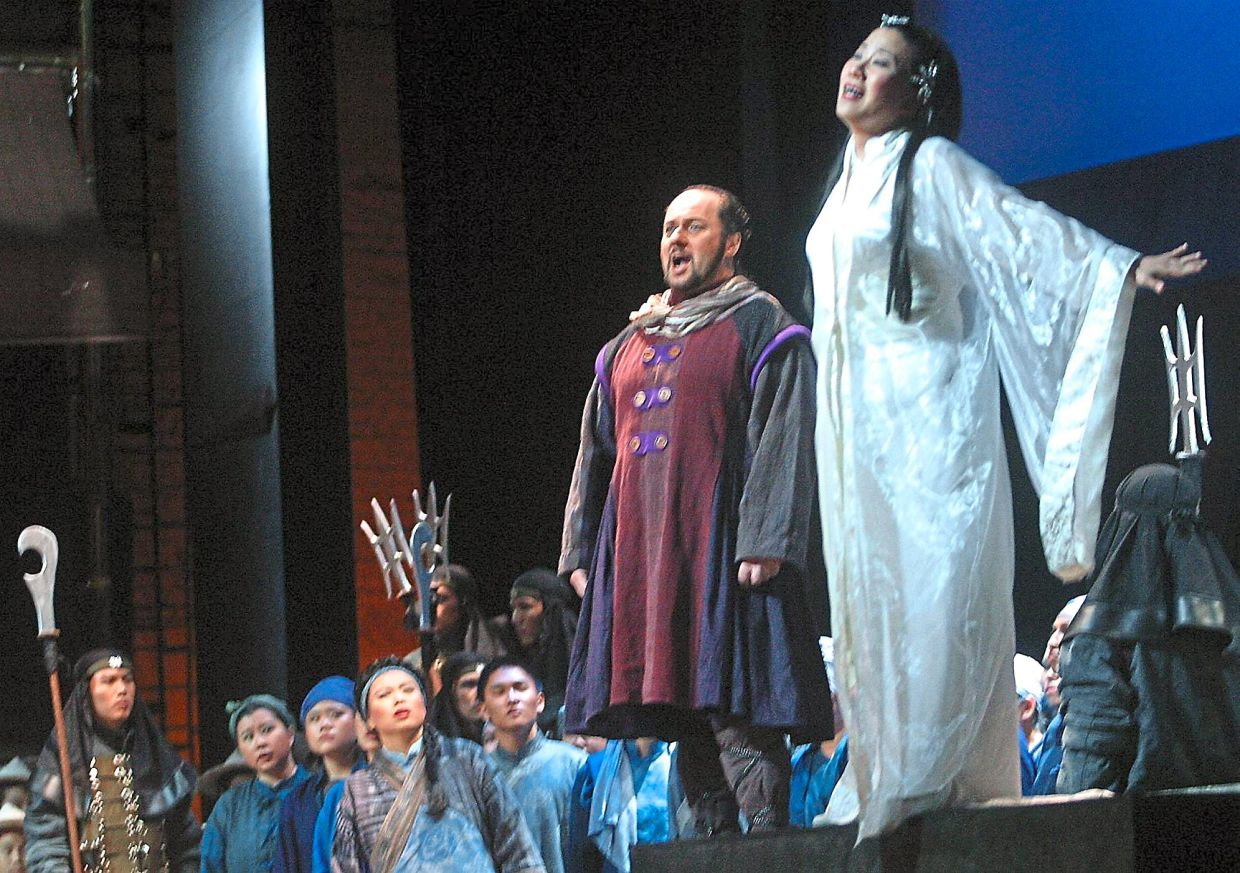 A scene from 'Turandot', which was organised by Penang Arts Council, at Dewan Sri Penang in December 2003. Hsing-An Chen (right) played Princess Turandot while Calaf was played by Dominic Natoli. Photo: Filepic