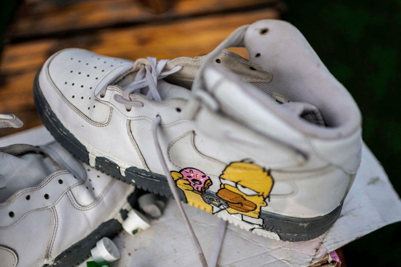 Sneakers ecstatically modified by graffiti artist Rasik