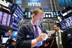 Dow hits record in stock rally as inflation fears recede