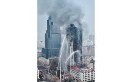 Huge fire engulfs 26-storey building in Shijiazhuang