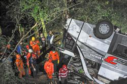 At least 27 killed after bus plunges into ravine