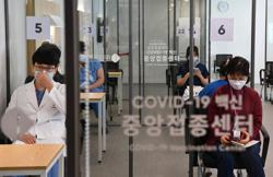 South Korea extends social distancing rules to stamp out infections amid vaccination drive