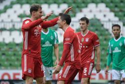 Soccer-Lewandowski landmark goal helps Bayern to 3-1 win at Werder