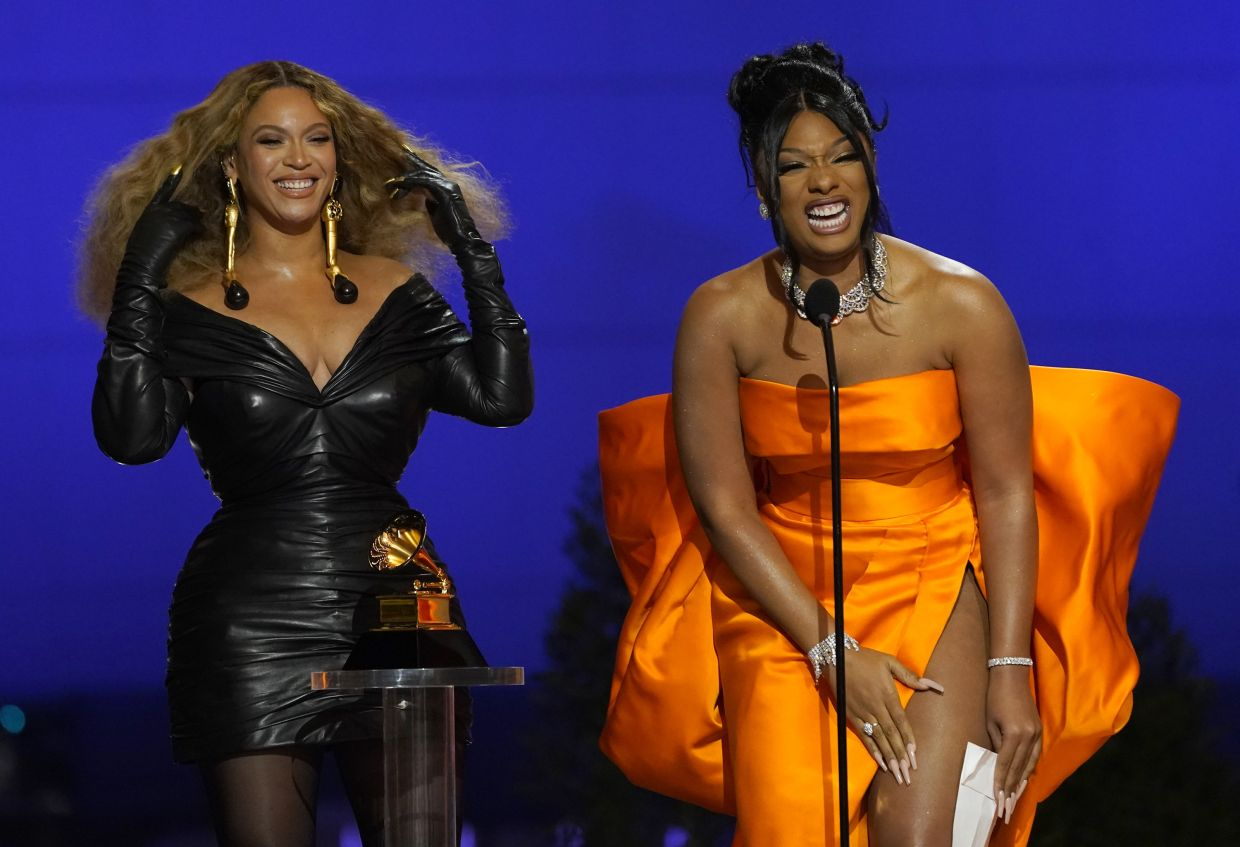 Beyonce (left) and Megan Thee Stallion accept the award for Best Rap Song for 'Savage' at the 63rd annual Grammy Awards at the Los Angeles Convention Center. Photo: AP