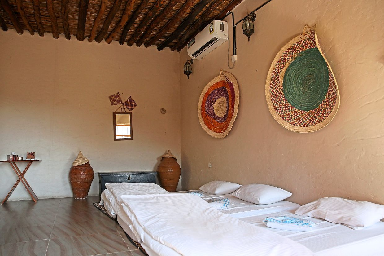 A room in one of the mud-brick hotels in the village, which was formerly a private home.
