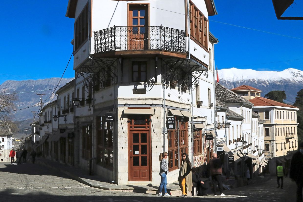Many old buildings in Gjirokastra were converted into tourism-related businesses before the pandemic hit.