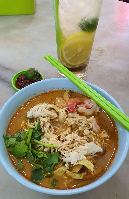 Kedai Kopi Yee Fung's laksa goes well with Kota Kinabalu's signature drink, kit chai ping. — MELODY L. GOH/The Star
