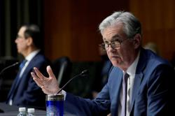 Fed expects growth surge, inflation jump in 2021 but no rate hike