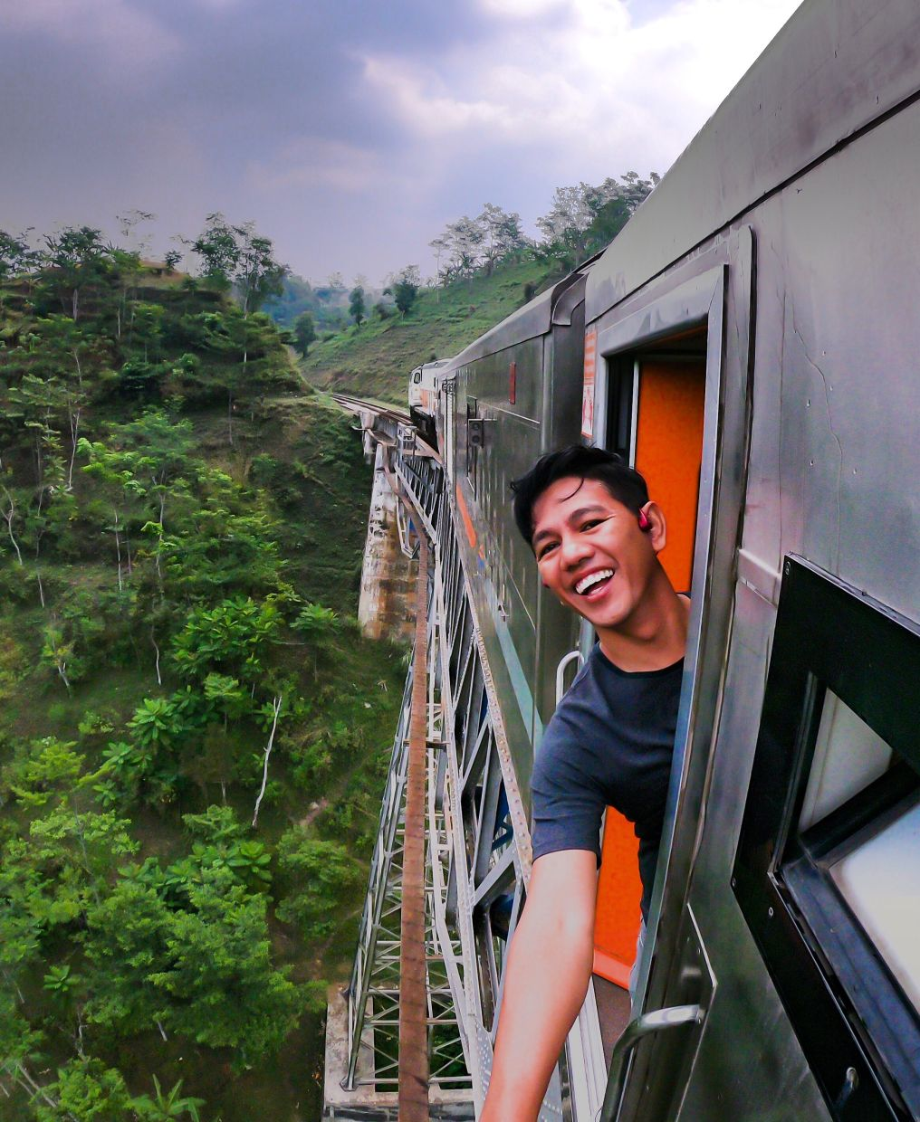 Being colour blind has never stopped Mohd Khairizal (on a train ride from Jakarta to Bandung, Indonesia, before the pandemic) from living a colourful life. Photo: Mohd Khairizal Mohd Khalif