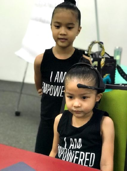 Two students from one family going through neurofeedback. Photo: Sarina Rhythmic Gymnastics Club