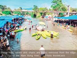 Laos cleans up riverside clutter at tourist spot Vangvieng