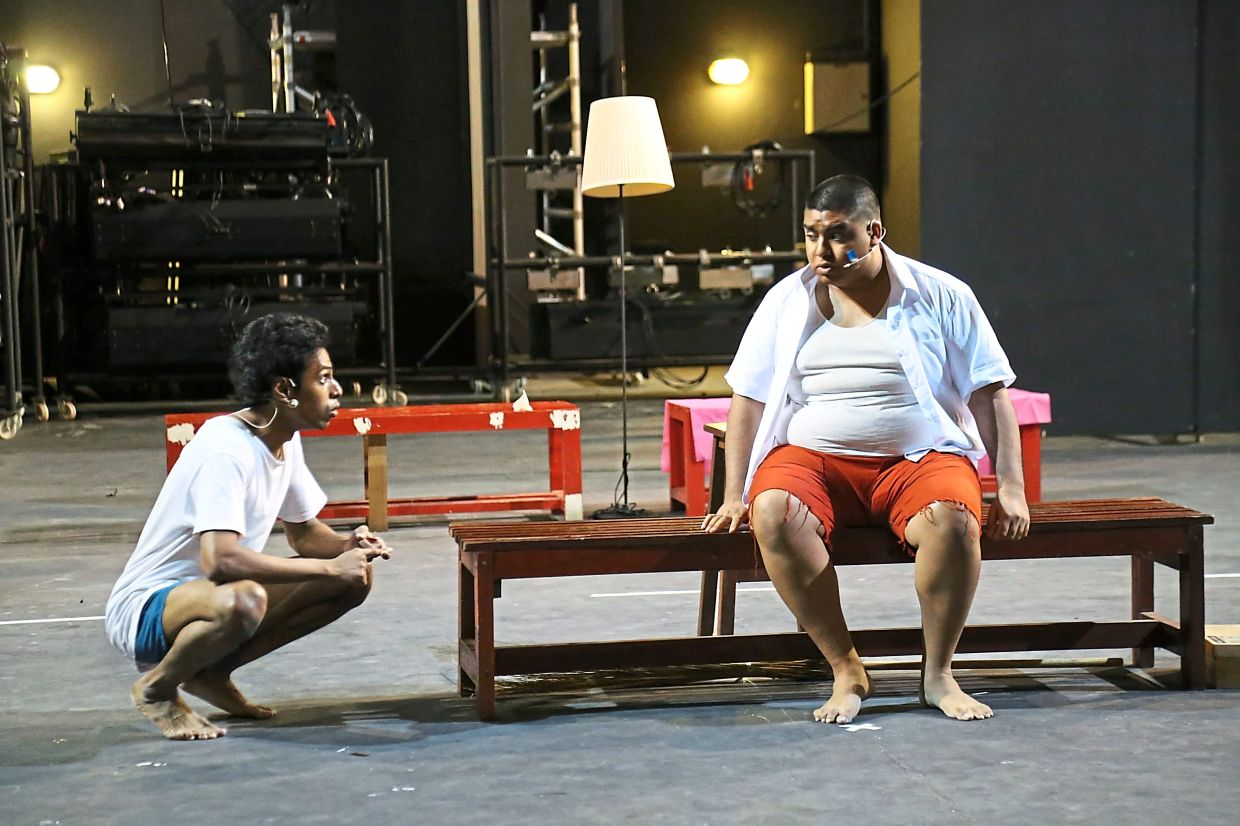 Tin Raman (left) and Ian Skatu play brothers Pappu and Babu in 'Bollywood Dreams', a play about escaping into fantasy land. Photo: KLPac