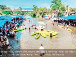 Laos: Vangvieng cleans up riverside clutter as dengue cases are on the rise again