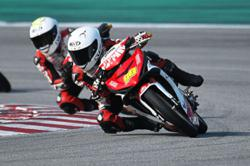 Izzat blazes to new lap record in Sepang