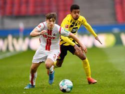 Soccer-Last-gasp Haaland gives Dortmund 2-2 draw at Cologne