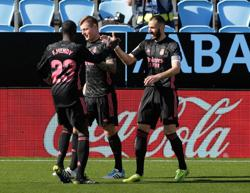 Soccer-Kroos-Benzema connection helps Real beat Celta
