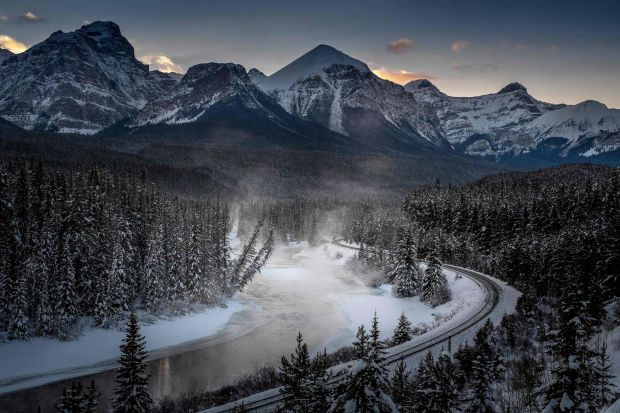 In this file photoa view of the famous 'Morant's Curve' offering a  view of the frozen Bow River and the Canadian Pacific Railway at Banff National park near Lake Louise, Canada. - AFP