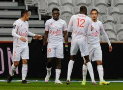 Soccer-Lille face losing top spot after defeat to Nimes