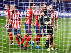 Soccer-Oblak saves late penalty to give Atletico nervy win over Alaves
