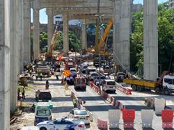 Two construction workers killed, two trapped after crane falls on car