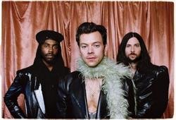 How Harry Styles made feather boas trendy by wearing one to the Grammys