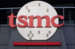 TSMC shares slide, as Taiwan plays down Intel's $20 billion expansion challenge