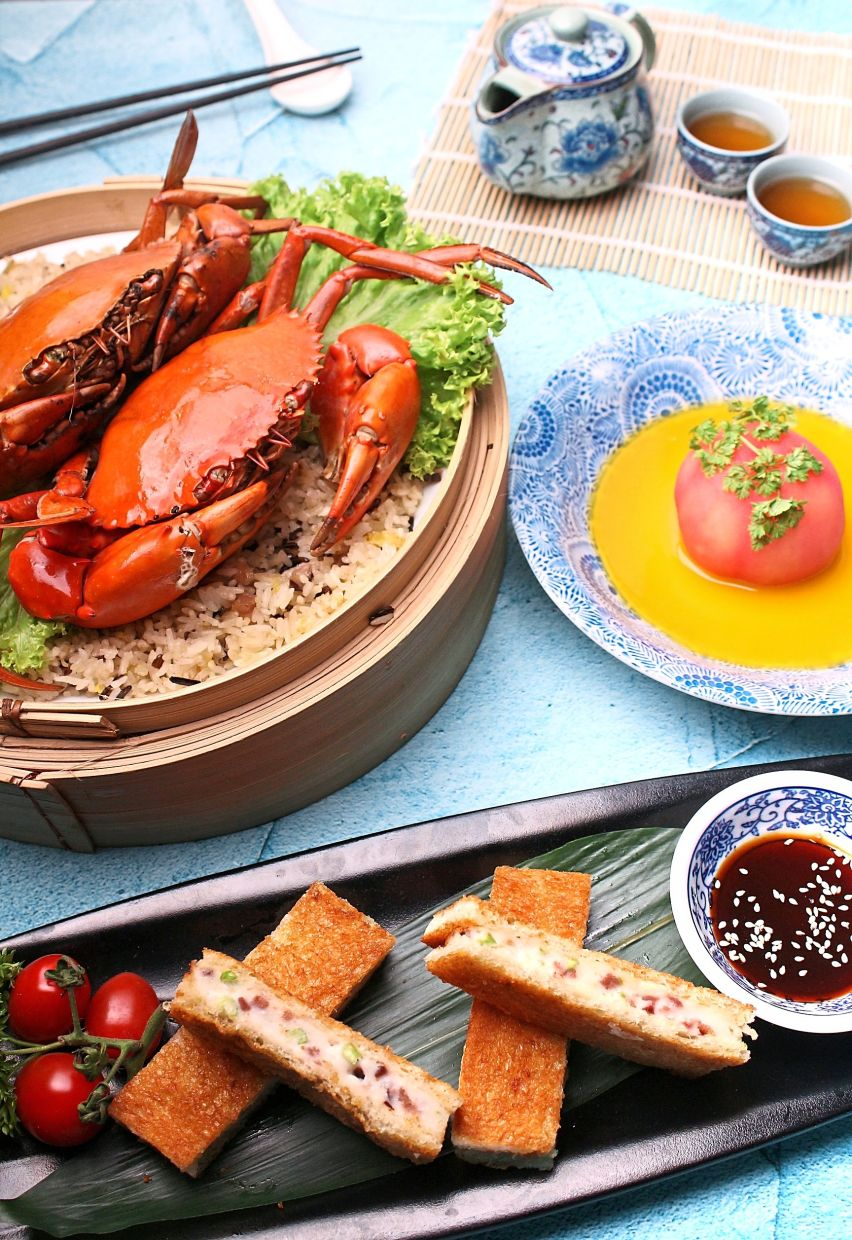 Five special dishes, including Steamed Live Mud Crab with Canadian Wild Rice in Bamboo Basket and Deep Fried Toast with Diced Roasted Duck Meat, Prawn Paste and Coriander,  will be featured until March 31 at Zuan Yuan Chinese Restaurant.