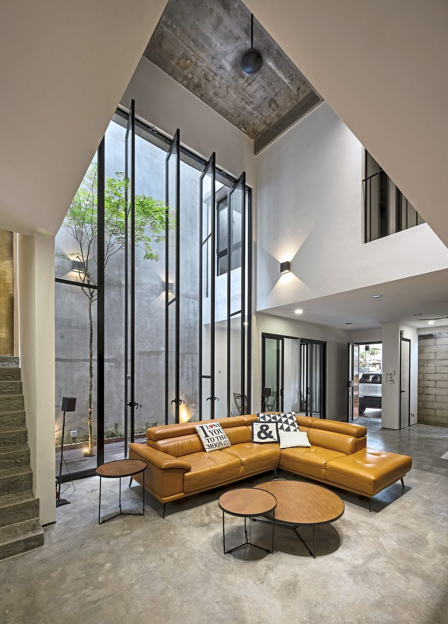At the NJ House in Putra Heights, Subang Jaya, two courtyards have been created and the principal rooms in the house look into these spaces.